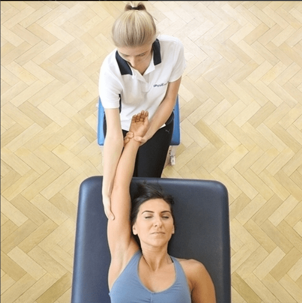 Woman recieving physiotherapy on her arm.