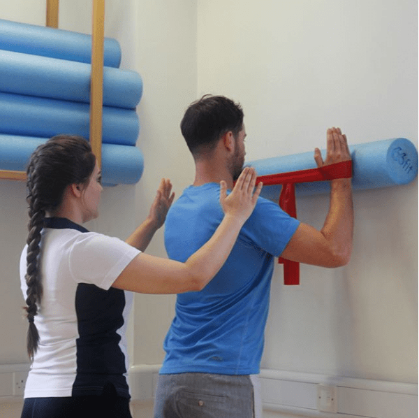 Physiotherapy against a wall.