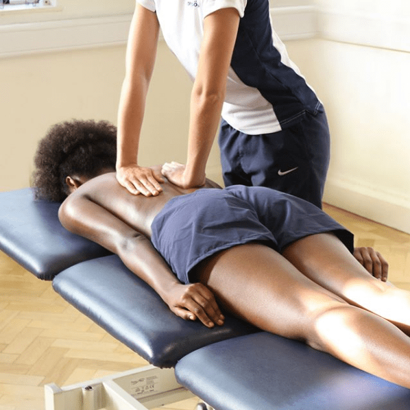 Woman receiving physiotherapy on her back