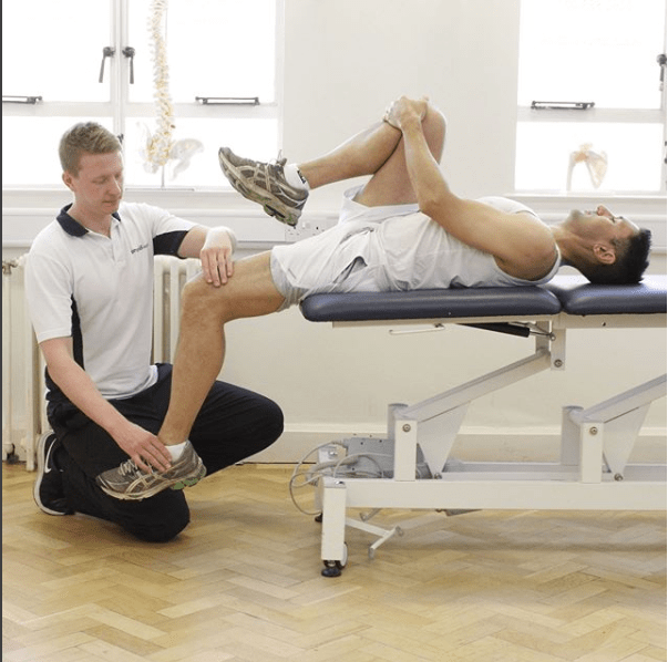Man having physiotherapy on his knee.