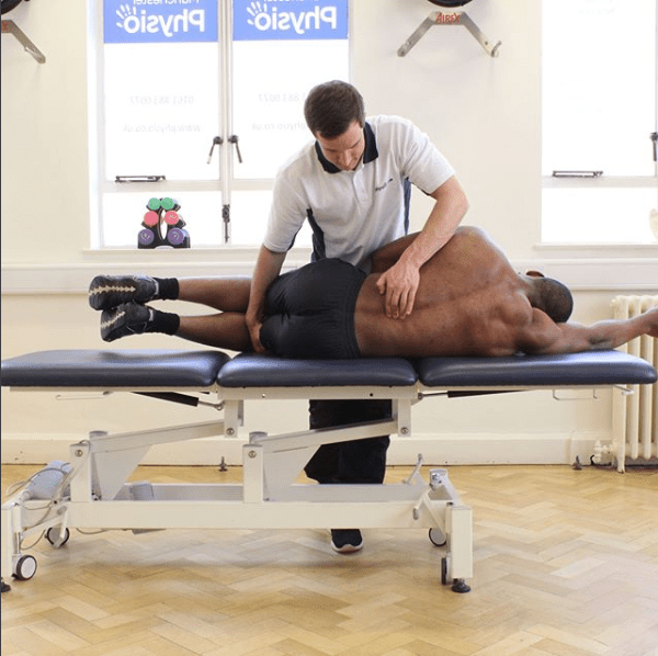 Man having physiotherapy on his back.