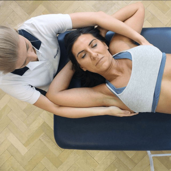 Woman having physiotherapy treatment on her shoulder.