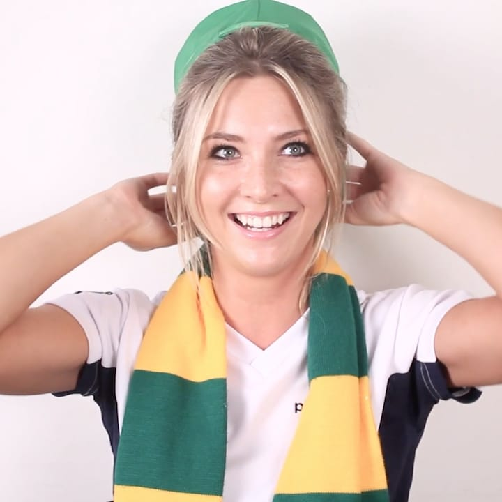Porttrait of Katie wearing green cap and yellow and green patterned scarf